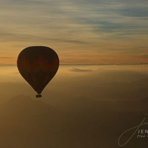 Hot Air Balloon in flight over Namibia at sunset